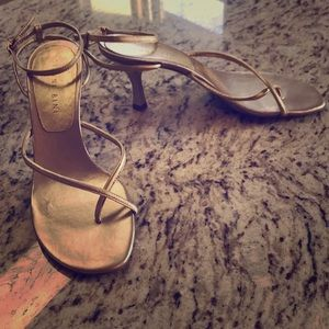 Gold formal sandals with low heel.